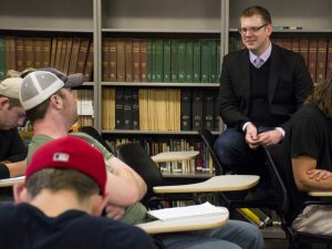 Professor Brian Leech (right) discusses the Great Society with a student group during his HIST-132 class.  Photo by Cam Best.