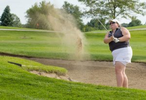 Junior Samantha Barlage chips a ball out of the sand trap and onto the green. Barlage's average score of 88.5 is leading the team as they go into the CCIW tournament Oct. 2 through 4.  Photo by Andrew Skalak.