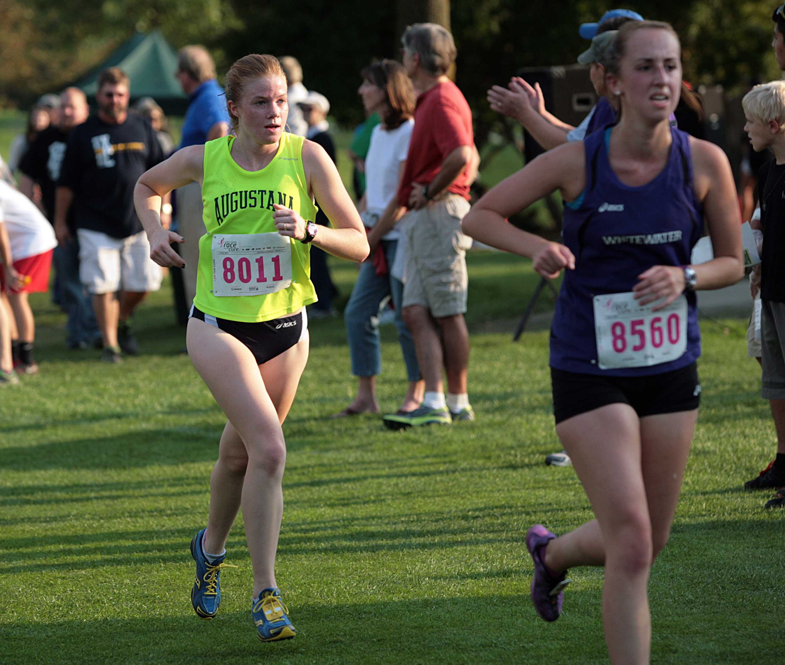 Junior Suzie Brashler runs towards the finish during Augustana's home meet, the Brissman/Lundeen Invitational, on the fields of Saukie Golf Course.  Photo by Hoang Nguyen.