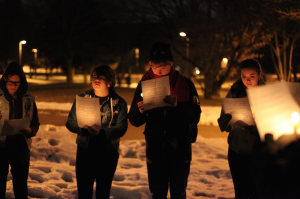 Augie lights candles for hate crime victims