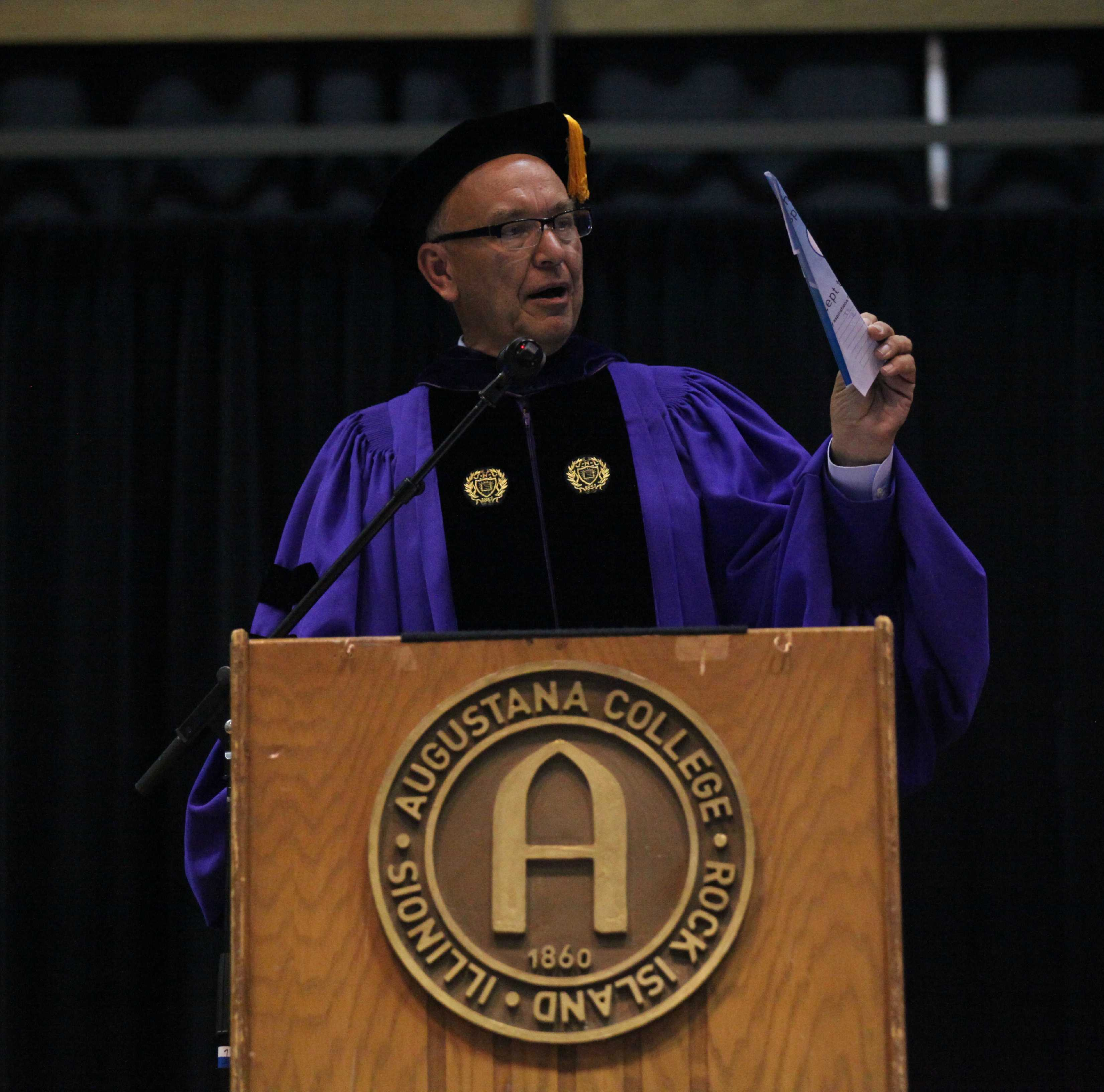 President Steven Bahls presents his paper airplane at the 2015 opening ceremony in Carver. File Photo by Augustana Observer