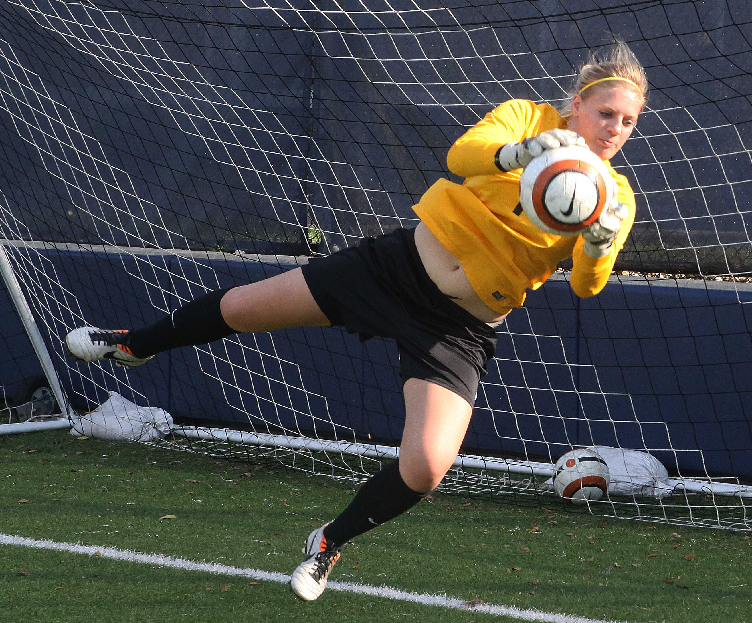 Senior Meredith Chew  snatches the ball during practice Sept. 28. The women's soccer team will be going up against CCIW rival Illinois Wesleyan on Oct. 3 at Illinois Wesleyan.