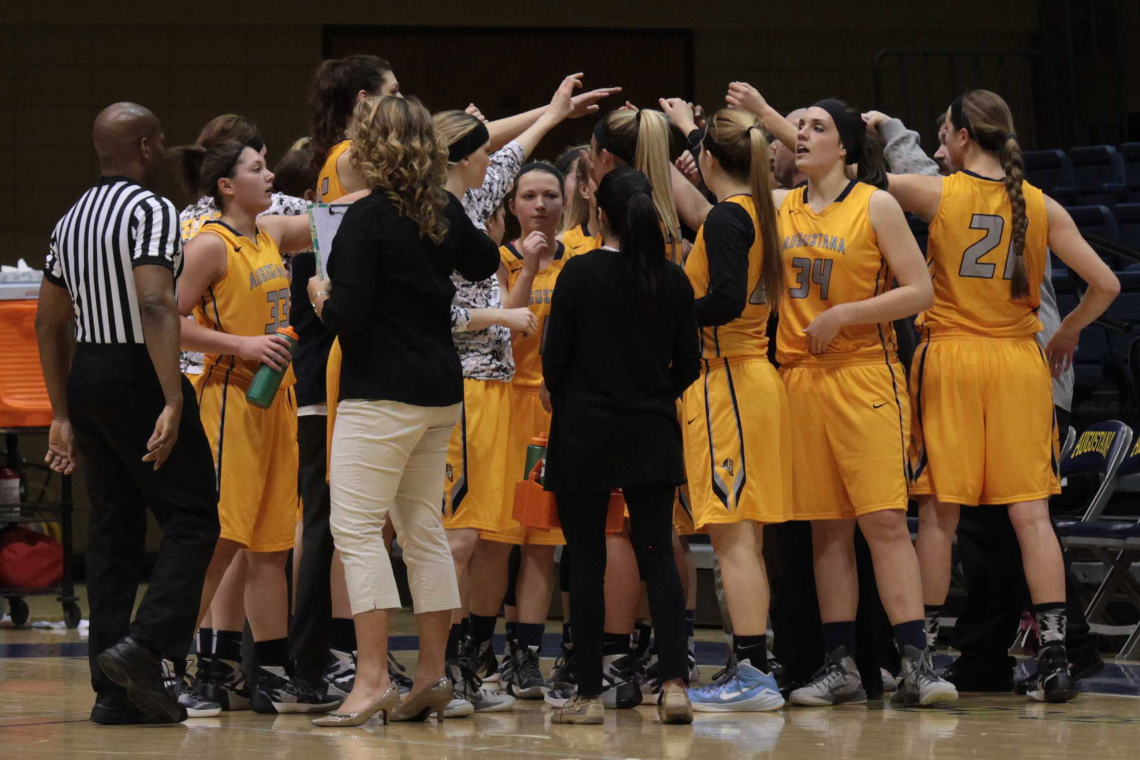 The Augustana women's basketball team huddles up after the first quarter of their game against Illinois Weslyan that took place on Wednesday night in the Carver Center. Photo by LuAnna Gerdemann.