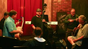 """Actors rehearse songs for """"The Big Rock Candy Mountain."""" The musical comedy"""