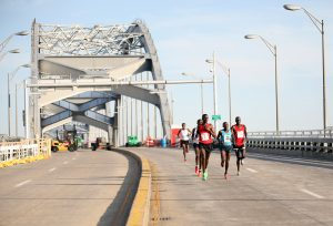 Sammy Malakwen (far right) of Kenya won the Quad Cities Marathon Saturday with a time of 2:15:42. The 17th annual marathon, which crossed two bridges, state lines and four cities, brought participants from across the world, including contestants from Kenya, Canada and the Netherlands. Photo by Linnea Ritchie