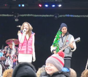 Kira Isabella and the Canadian Pacific Holiday Train Band perform Christmas music at the train's Davenport stop on Dec. 5.  Photo Credit: Sarah Ritter/Observer Staff