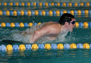 Junior David Sommers swims during one of the team's 6 a.m. practices in preparation for an upcoming meet.  Photo by Hoang Nguyen.