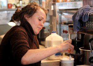 Barista Amanda Olson prepares an order. Olson works at Theo's Java Club, which served as the coffee shop in Augustana's library for 11 years. Photo by Sarah Ritter.