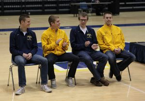 The Men's Track and Field 1,600 relay team are recognized at a pep rally on March 24. From left: David Voland, Keith Cline, David Devore, and Isaac Smith.  Photo by Linnea Ritchie.
