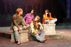 """Madison Rodgers/Observer Staff Students in the Theatre Department rehearse the spring play, dressed as hippies in the Vietnam Era. This year, Augustana Theatre's spring production, directed by Jennifer Popple, is a twist on a classic Shakespeare play. """"As You Like It"""" combines Vietnam with Shakespeare's wit, to tackle modern issues of identity, gender and love."""