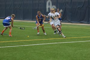 Junior attacker Rebecca Pollard lunges for the ball during the Vikings home NCAA appearance against Concordia Wisconsin.