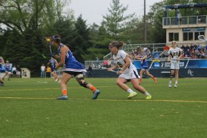 Senior captain and mid-fielder Kelly Stelzer plays defense against Concordia Wisconsin Saturday, May, 10.