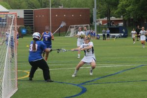 Senior attacker Hilary Kargl shoots and scores against Concordia Wisconsin on Sunday, May, 10. The Vikings went on to win with a score of 19-13.