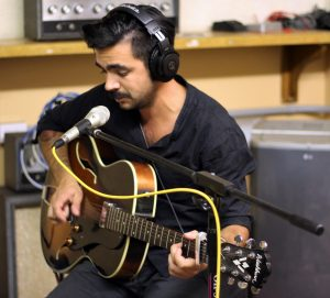 In a Daytrotter recording booth, artist Phill Reynolds prepares to record a new song. Photo by Christie Beach.
