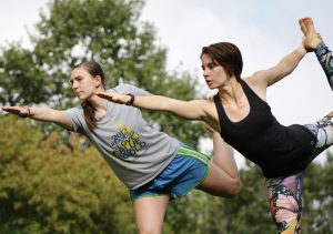 Senior Eleanor Nolan and Clarissa Thompson, assistant director of student employment and campus internships, strike a few yoga poses on the Quad. Thompson lead a yoga and meditation session for the Day of Self-Care.  Photo by LuAnna Gerdemann.