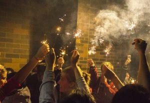 Augustana students enjoy Diwali with sparklers. Photo by JanieLe.