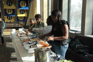 The BSU executive board sets up the food for the Thanksgiving meal. Photo by LuAnna Gerdemann.